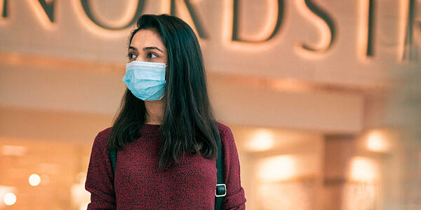 Woman collects shopping wearing a mask due to covid-19