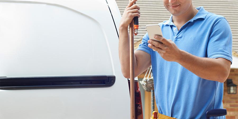 Technician using mobile worker app
