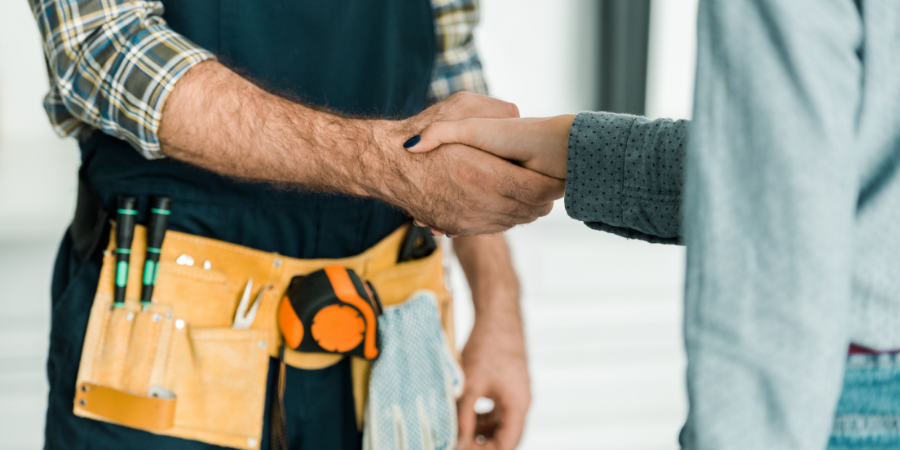 Technician shaking hands with happy customer