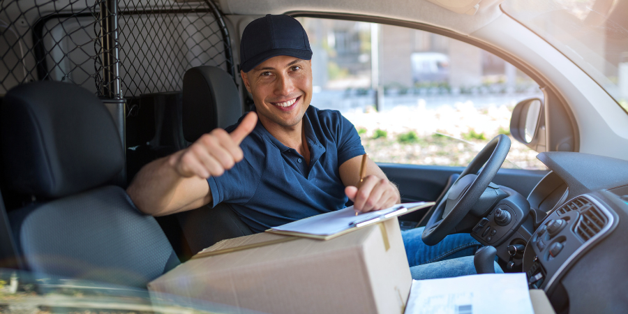 Delivery driver on his way to deliver customer parcels
